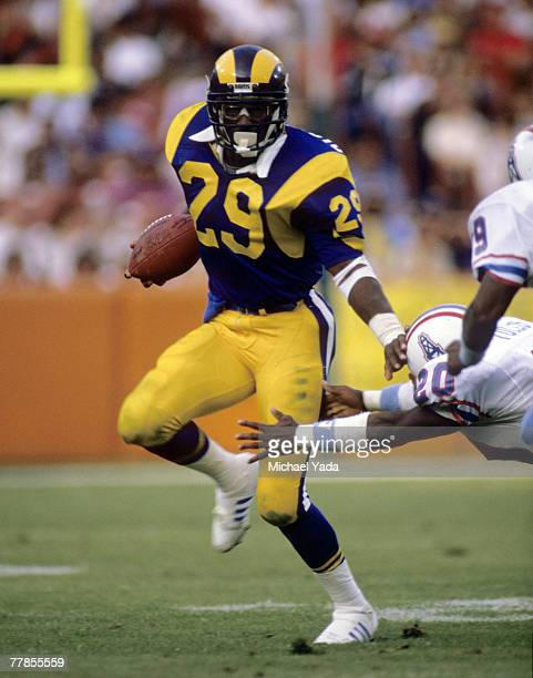 Los Angeles Rams running back Eric Dickerson inducted into the Pro Football Hall of Fame class of 1999 carries the ball during a 2716 victory over...