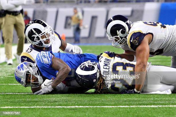 Los Angeles Rams running back John Kelly and Los Angeles Rams defensive back Nickell RobeyColeman take down Detroit Lions wide receiver Bruce...