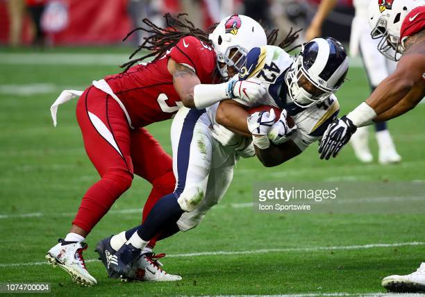 Los Angeles Rams running back John Kelly gets tackled during the NFL football game between the Arizona Cardinals and the Los Angeles Rams on December...