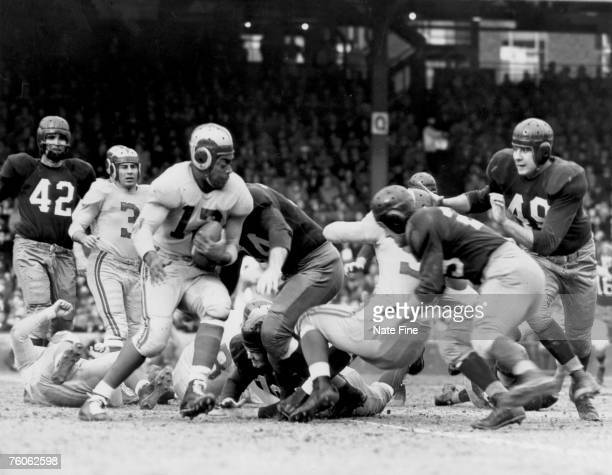 Los Angeles Rams running back Les Horvath on a carry in a 4113 win over the Washington Redskins on December 5 1948 at Griffith Stadium in Washington...