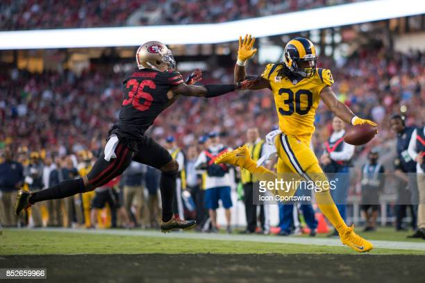 Los Angeles Rams running back Todd Gurley beats San Francisco 49ers cornerback Dontae Johnson to score a touch down during an NFL game between the...
