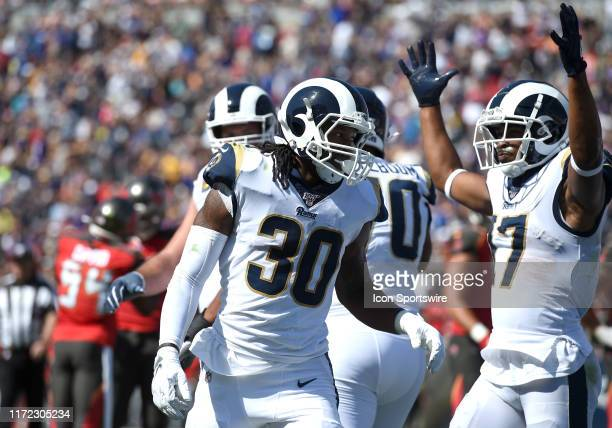 Los Angeles Rams Running Back Todd Gurley II celebrates with Los Angeles Rams Wide Receiver Robert Woods after running for a touchdown during an NFL...