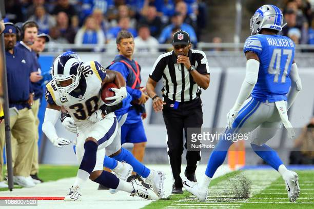 Los Angeles Rams running back Todd Gurley is taken down by Detroit Lions middle linebacker Jarrad Davis during an attempt to gain yardage during the...