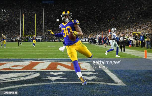 Los Angeles Rams running back Todd Gurley scores a touchdown against the Dallas Cowboys at Los Angeles Memorial Coliseum on January 12 2019 in Los...