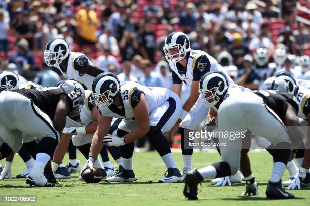 Los Angeles Rams Sean Mannion waits for the snap from Los Angeles Rams Brian Allen during an NFL preseason game between the Oakland Raiders and the...