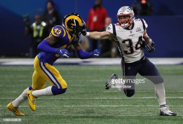 Los Angeles Rams strong safety John Johnson chases New England Patriots running back Rex Burkhead during the first quarter The New England Patriots...