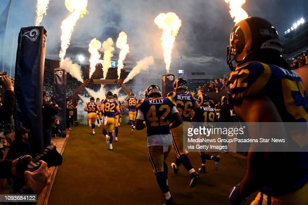 Los Angeles Rams take the field prior to a NFL playoff football game against the Dallas Cowboys at the Los Angeles Memorial Coliseum on Saturday...