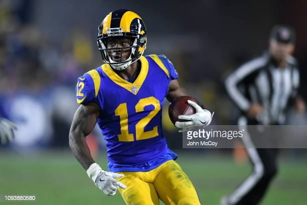 Los Angeles Rams wide receiver Brandin Cooks runs the ball against the Dallas Cowboys at Los Angeles Memorial Coliseum on January 12 2019 in Los...
