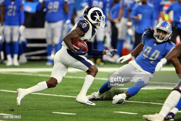 Los Angeles Rams wide receiver JoJo Natson runs the ball under the pressure of the Detroit Lions defense during the first half of an NFL football...