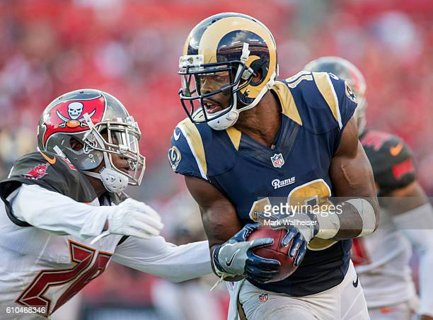 Los Angeles Rams wide receiver Kenny Britt turns up field after a reception and into the arms of Tampa Bay Buccaneers cornerback Vernon Hargreaves...