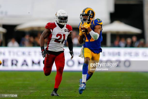Los Angeles Rams wide receiver Robert Woods catches the ball against Arizona Cardinals cornerback Patrick Peterson during an NFL game between the...