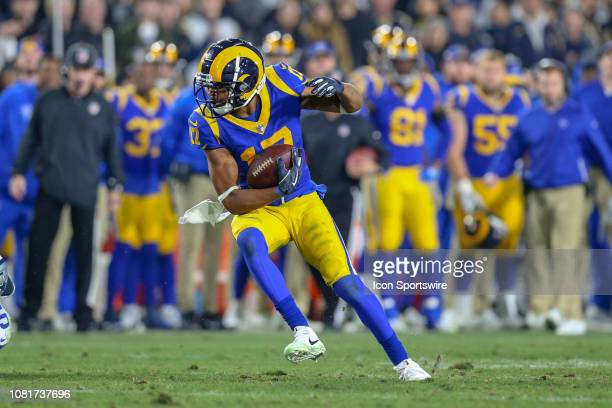 Los Angeles Rams wide receiver Robert Woods catches the ball for a gain during the NFC Divisional Football game between the Dallas Cowboys and the...