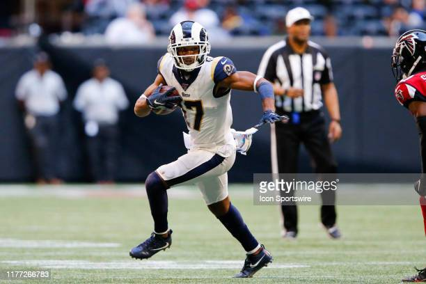Los Angeles Rams wide receiver Robert Woods catches the ball for a gain during an NFL football game between the Los Angeles Rams and the Atlanta...