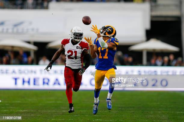 Los Angeles Rams wide receiver Robert Woods catches the ball while being guarded by Arizona Cardinals cornerback Patrick Peterson during an NFL game...