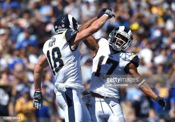 Los Angeles Rams Wide Receiver Robert Woods celebrates with Los Angeles Rams Wide Receiver Cooper Kupp after scoring a touchdown in the first quarter...