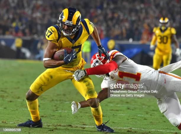 Los Angeles Rams wide receiver Robert Woods is stopped by Kansas City Chiefs strong safety Eric Murray after a reception that set up a Rams touchdown...