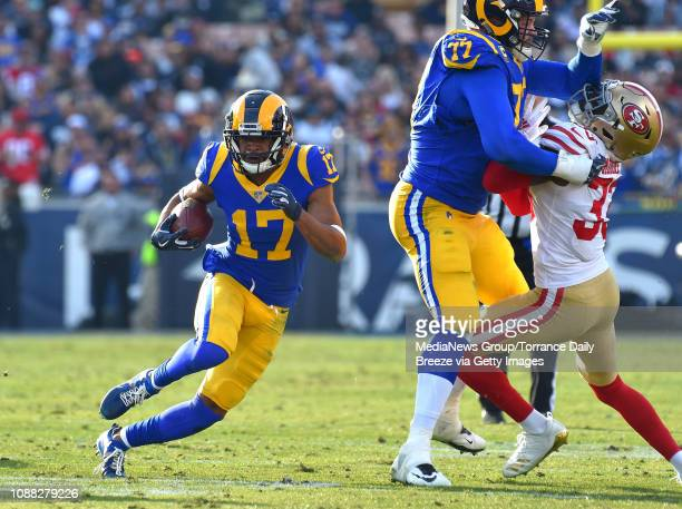 Los Angeles Rams wide receiver Robert Woods picks up a first down after a reception in Los Angeles on Sunday, Dec. 30, 2018.