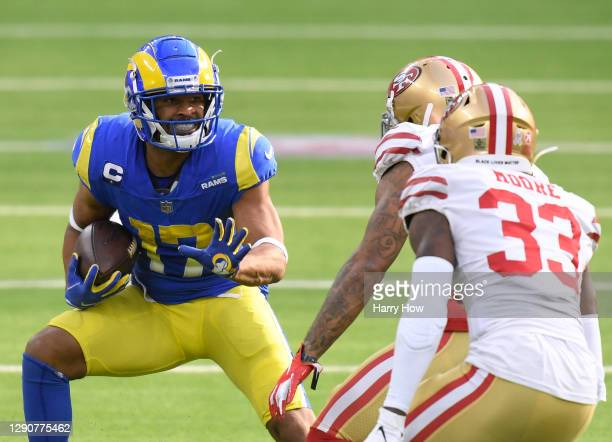 Los Angeles Rams wide receiver Robert Woods runs after his catch in front of cornerback Jamar Taylor and San Francisco 49ers defensive back Tarvarius...