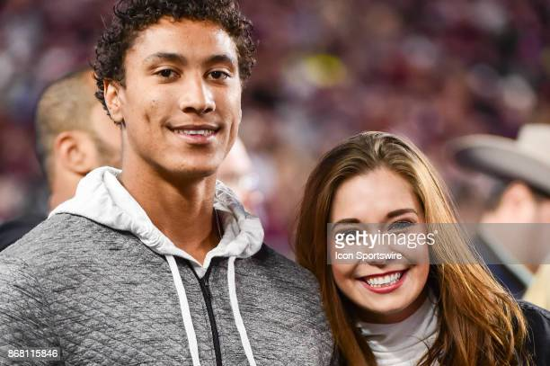 Los Angeles Rams wide reciever and former Aggie Josh Reynolds and his girlfriend Haley watch from the sideline during the football game between the...