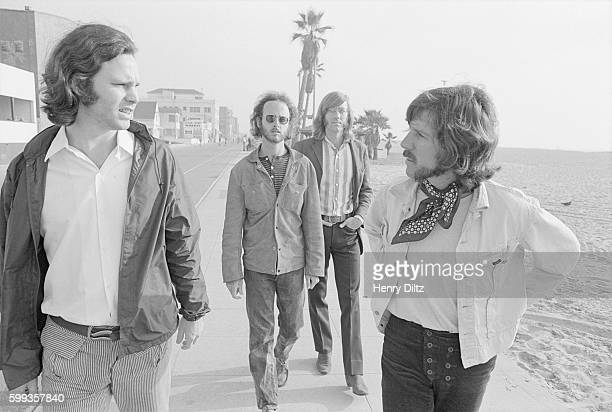Los Angeles rock group The Doors singer Jim Morrison guitarist Robbie Krieger keyboardist Ray Manzarek and drummer John Densmore walk along a...