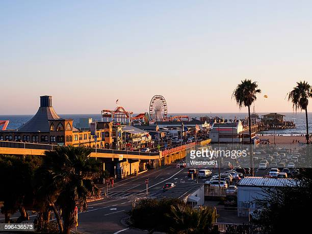 USA, Los Angeles, Santa Monica Beach Pier and Pacific Park at sunset
