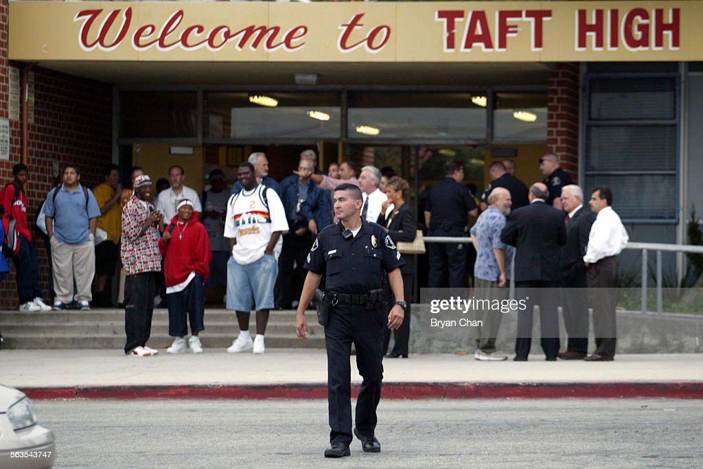Los Angeles School Police Officer Al Espinosa (cq) keeps watch at the entrence to Taft High School a : News Photo