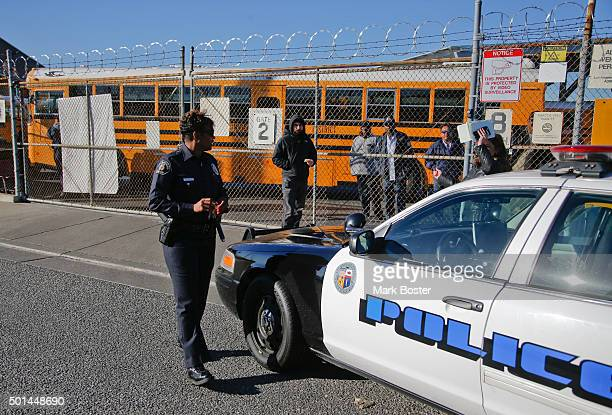 Los Angeles School Police officer checks-in with officials at the LAUSD Gardena Garage where the fleet of school buses from around the district...
