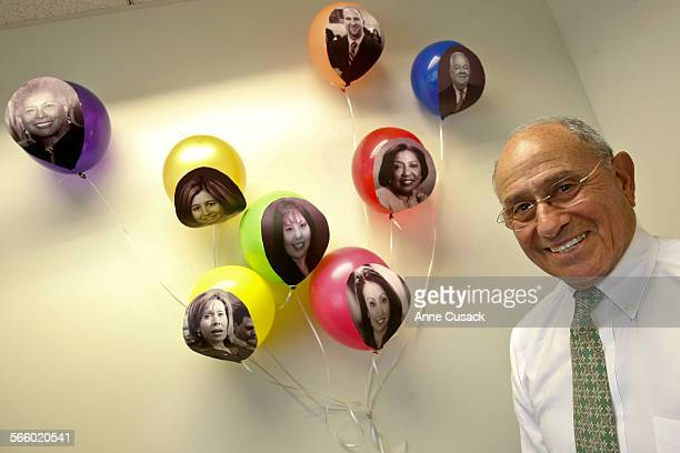 Los Angeles School Superintendent Ramon C Cortines poses for a portrait in his new office on his birthday with balloons given him by the staff at the...