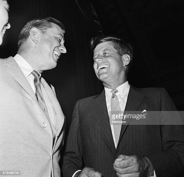 Senator John Kennedy chats with Franklin D Roosevelt Jr at a reception given by Kennedy on the eve of the Democratic National Convention