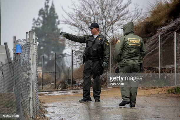 Los Angeles sheriff deputies looking for homeless encampments along San Gabriel to warn inhabitants about the danger of flooding and to provide them...