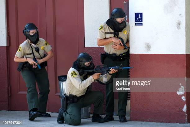 Los Angeles Sheriffs deputies participate in an active shooter drill in a high school near Los Angeles, California on August 16, 2018.