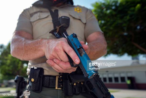 A Los Angeles Sheriffs deputy participates in an active shooter drill in a high school near Los Angeles California on August 16 2018
