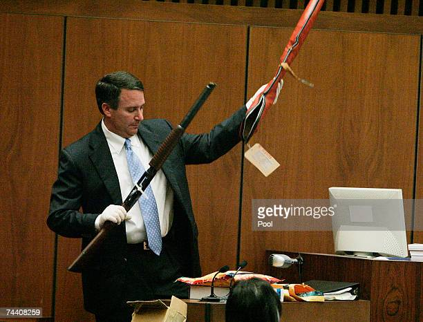Los Angeles sheriff's Detective Mark Lillienfeld, the chief investigator at the scene of the death of Lana Clarkson, displays a shotgun, one of...