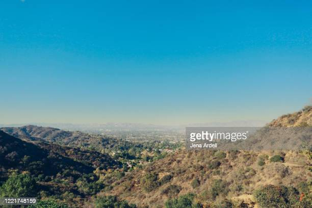 los angeles smog over san fernando valley, smoggy sky in california, view from hiking in los angeles - city of los angeles stock pictures, royalty-free photos & images