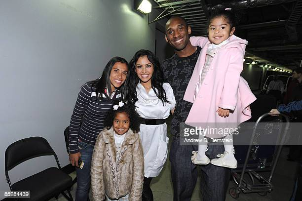 Los Angeles Sol player Marta Viera da Silva poses with Kobe Bryant of the Los Angeles Lakers and his wife Vanessa, and their daughters Natalia and...