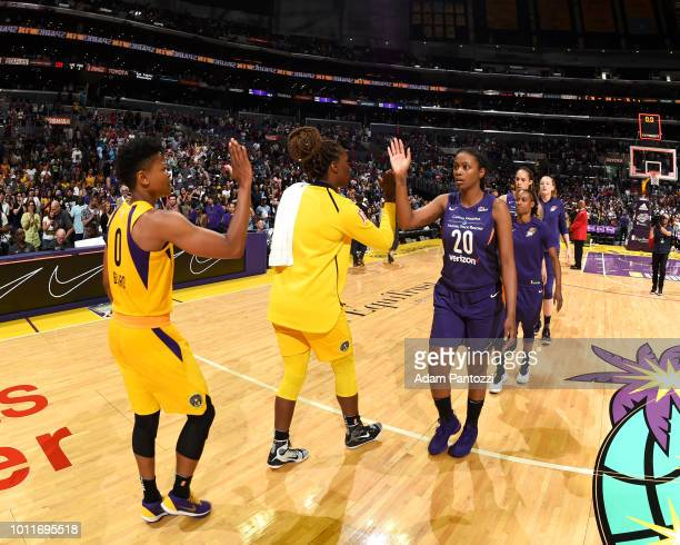 Los Angeles Sparks and Phoenix Mercury highfive after the game between the two teams on August 5 2018 at The Staples Center in Los Angeles California...