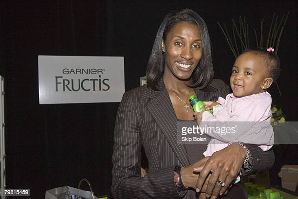 Los Angeles Sparks center Lisa Leslie poses with her baby at the Garnier Fructis Style booth in the NBA All-Stars gifting suite at the Sheraton Hotel...