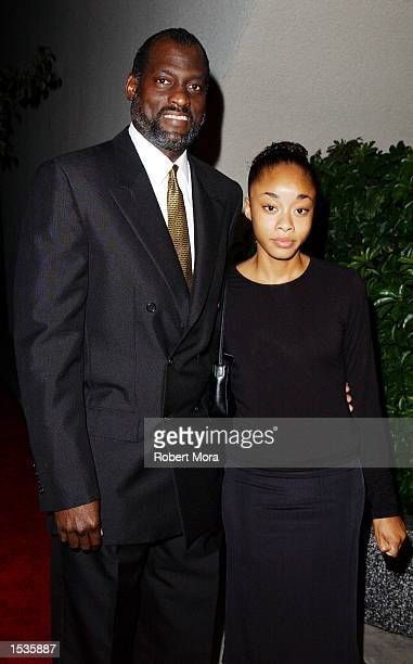 Los Angeles Sparks coach Michael Cooper and daughter Simone attend the Friars Club Lifetime Achievement Award Gala honoring Earvin Magic Johnson at...