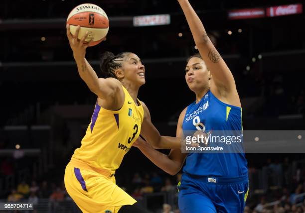Los Angeles Sparks forward Candace Parker drives the ball to the basket during the game between the Dallas Wings and the Los Angeles Sparks on June...
