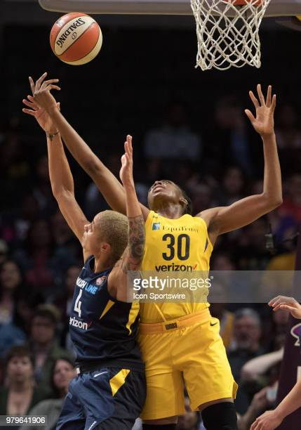 Los Angeles Sparks forward Nneka Ogwumike and Indiana Fever forward Candice Dupree go up for a rebound during the game between the Indiana Fever and...