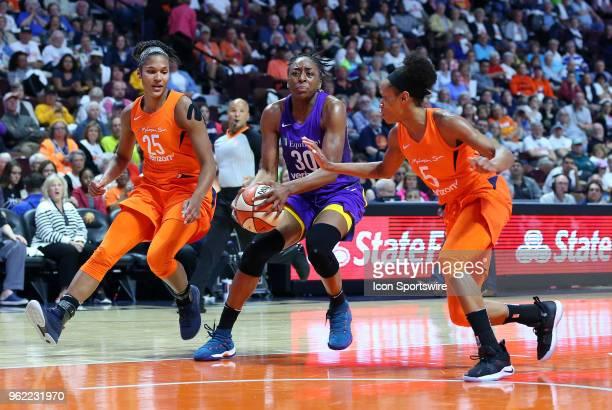 Los Angeles Sparks forward Nneka Ogwumike defended by Connecticut Sun forward Alyssa Thomas and Connecticut Sun guard Jasmine Thomas during a WNBA...
