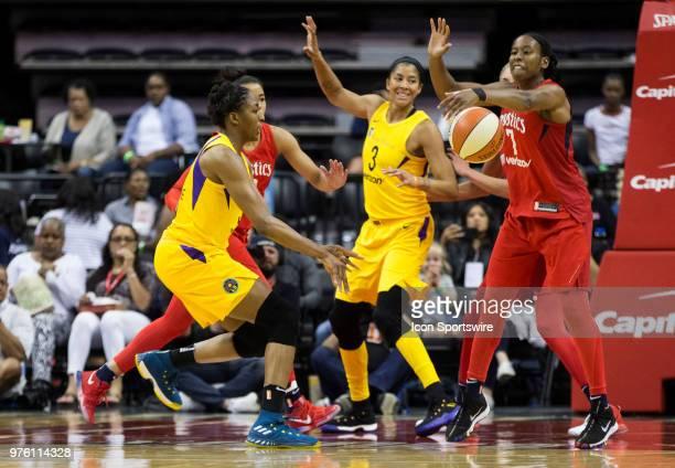 Los Angeles Sparks forward Nneka Ogwumike sends a pass past Washington Mystics guard Ariel Atkins during a WNBA game between the Washington Mystics...