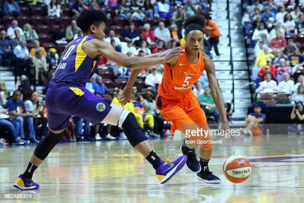 Los Angeles Sparks guard Alana Beard defends Connecticut Sun guard Jasmine Thomas during a WNBA game between Los Angeles Sparks and Connecticut Sun...