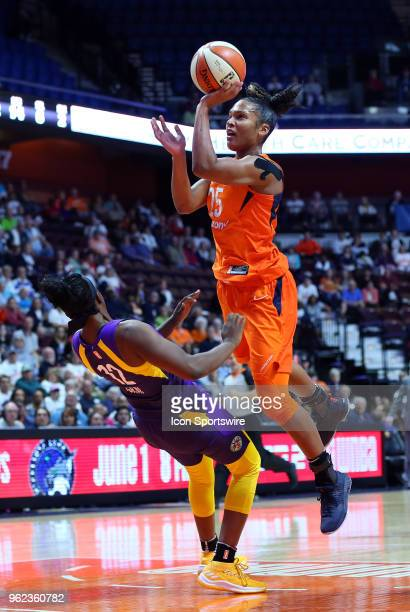 Los Angeles Sparks guard Chelsea Gray attempts to pick up the offensive foul against Connecticut Sun forward Alyssa Thomas during a WNBA game between...