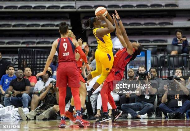 Los Angeles Sparks guard Chelsea Gray pushes into Washington Mystics guard Ariel Atkins during a WNBA game between the Washington Mystics and the Los...