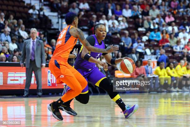 Los Angeles Sparks guard Odyssey Sims defended by Connecticut Sun guard Courtney Williams during a WNBA game between Los Angeles Sparks and...