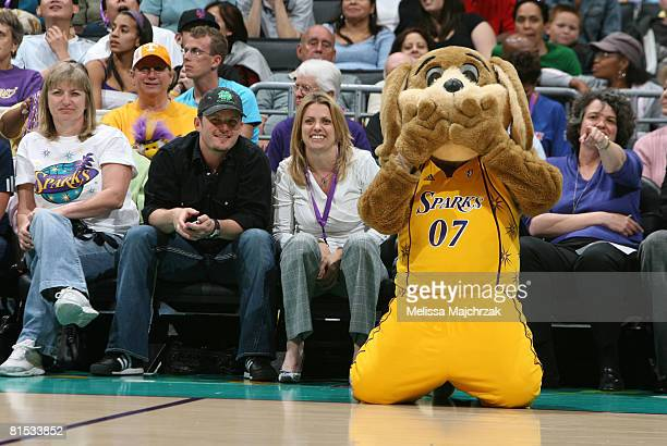 Los Angeles Sparks' mascot Sparky sits among fans while the Sparks take on the Detroit Shock at Staples Center on June 11 2008 in Los Angeles...