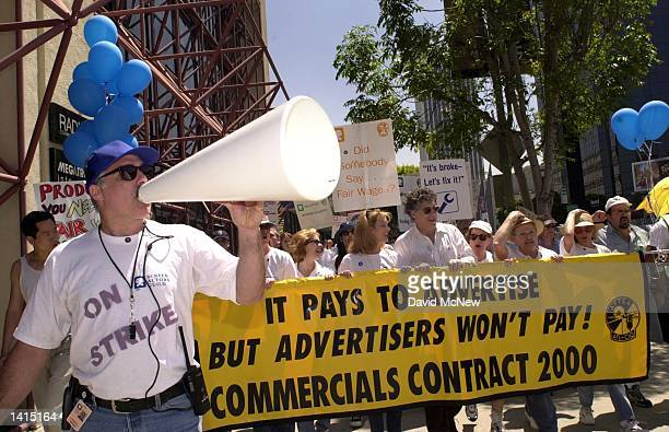 Los Angeles strike coordinator Gordon Drake leads striking actors from SAG and AFTRA actors unions in a chant while marching down Wilshire Blvd. To...