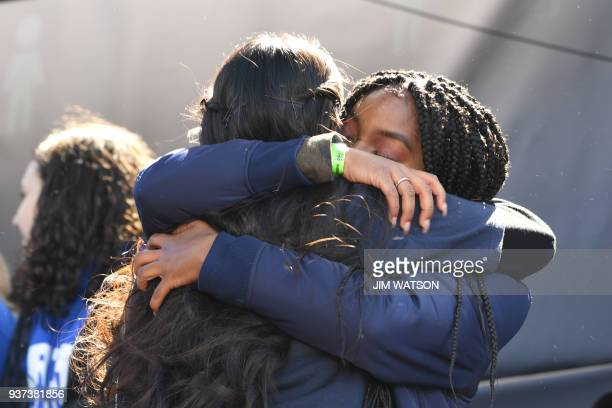 Los Angeles student Edna Chavez receives a hug at the March for Our Lives rally in Washington, DC on March 24, 2018. Galvanized by a massacre at a...