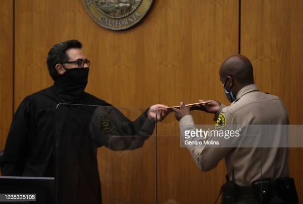 Los Angeles Superior Court Judge Mark E. Windham receives the verdict from the bailiff before finding New York real estate heir Robert Durst guilty...